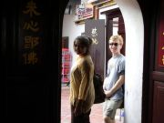 Fahmida and Scott posing in Melaka's Chinatown.